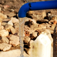 BluePump hand pump and water.
