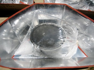 Closeup of solar Cookkit with pot inside a plastic bage.