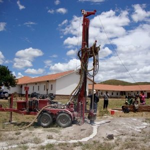 Maji Mengi drilling rig drilling a borehole at a school.